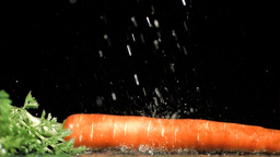 Carrot in super slow motion being soaked Stock Video Footage