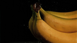 Rain falling in super slow motion on bananas Footage