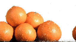 Tasty oranges in super slow motion being soaked Footage