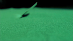 Card thrown in super slow motion on a table Footage