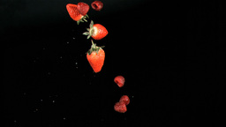 Red fruits being throw in super slow motion Live Action