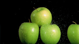 Water sprayed on apples in super slow motion Stock Video Footage