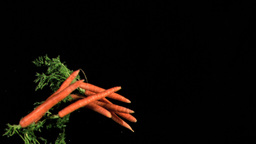 Carrots falling in super slow motion Stock Video Footage