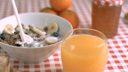 Milk poured in super slow motion on cereals Stock Video Footage