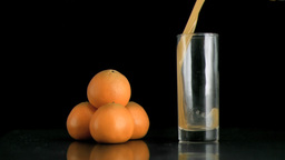 Tangerine juice being poured in super slow motion Footage