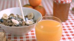 Milk flowing in super slow motion in cereals Footage