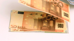 Wind blowing in super slow motion on euro banknotes Footage