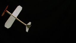 Wooden plane flying in super slow motion Footage