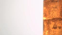 Ice bubbling in super slow motion in apple juice Footage