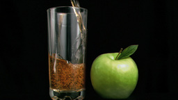 Fresh apple juice flowing in super slow motion Footage