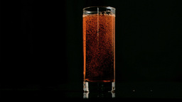 Amber Fizzy Drink Bubbling In Super Slow Motion In stock footage