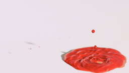Colored liquid dripping in super slow motion Stock Video Footage