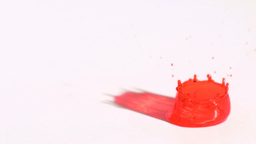 Red drop splashing in super slow motion Stock Video Footage