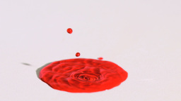 Red liquid splashing in super slow motion Footage