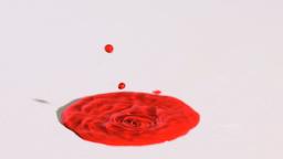 Red liquid splashing in super slow motion Footage