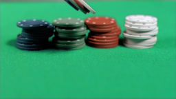 Gambling chips falling down in super slow motion Footage