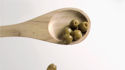Olives falling in super slow motion from the spoon Stock Video Footage