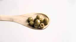 Spoon tipping olives in super slow motion Stock Video Footage