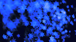 Blue stars floating in super slow motion in the air Animation