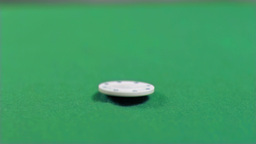 White gambling chip falling in super slow motion Stock Video Footage
