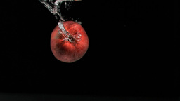 Apple diving in super slow motion Stock Video Footage