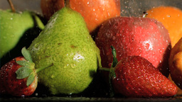 Fruits being watered in super slow motion Stock Video Footage