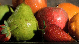 Fruits being watered in super slow motion Footage