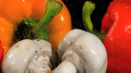 Drops falling in super slow motion on vegetables Stock Video Footage