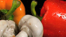 Drops falling in super slow motion on vegetables Footage