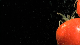 Water poured in super slow motion on tomatoes Stock Video Footage