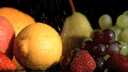 Drops falling in super slow motion on fruits Stock Video Footage