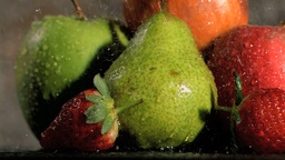 Rain falling in super slow motion on fruits Footage