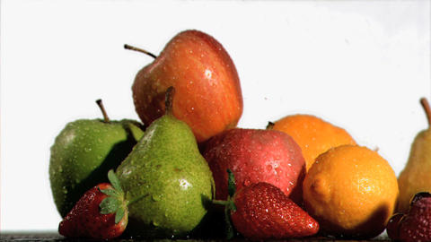 Water sprayed on fresh fruits in super slow motion Stock Video Footage