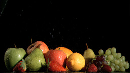 Many fruits sprayed in super slow motion with wate Footage