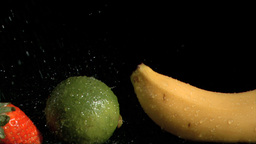 Fruits sprayed in super slow motion by water Footage