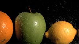 Fruits in line watered in super slow motion Footage