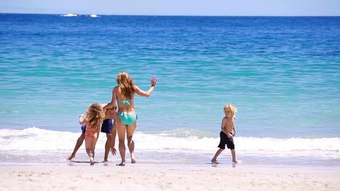 Family enjoying vacation at beach Animation
