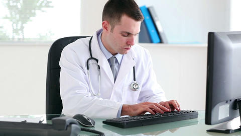 Doctor using a computer Footage