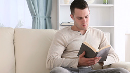 Concentrated man reading a book Footage