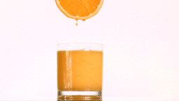 Drops of orange juice in super slow motion droppin Footage
