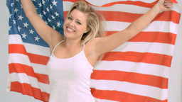 Smiling woman in slow motion holding the American flag Stock Video Footage