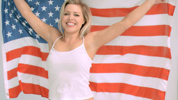 Smiling woman in slow motion holding the American  Footage