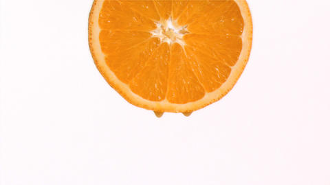 Drop of orange juice in super slow motion falling Stock Video Footage