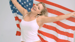 Blonde woman in slow motion holding the American f Footage