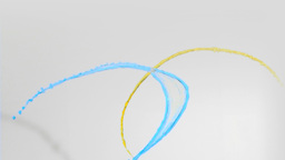 Blue and yellow paint in super slow motion rising Footage
