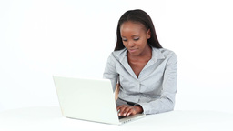 Woman typing on a computer while sitting at a desk Stock Video Footage