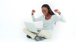 Woman celebrating while looking at a computer Footage