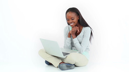 Woman celebrating while looking at a computer Stock Video Footage