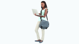 Woman standing while holding a laptop Footage