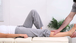 Lower leg of a woman being stretched by a physioth Stock Video Footage